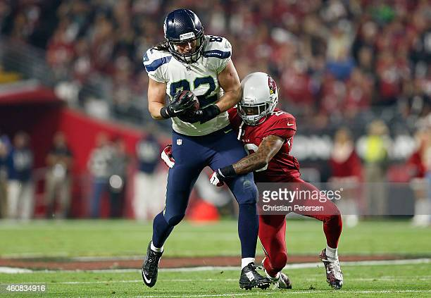 Tight end Luke Willson of the Seattle Seahawks runs with the football against free safety Rashad Johnson of the Arizona Cardinals during the NFL game...