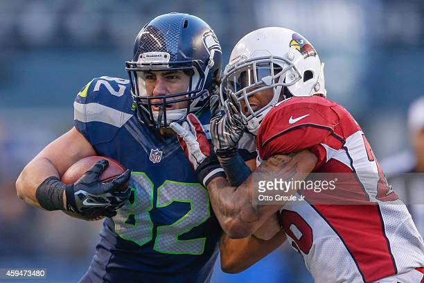 Tight end Luke Willson of the Seattle Seahawks rushes against free safety Rashad Johnson of the Arizona Cardinals at CenturyLink Field on November 23...