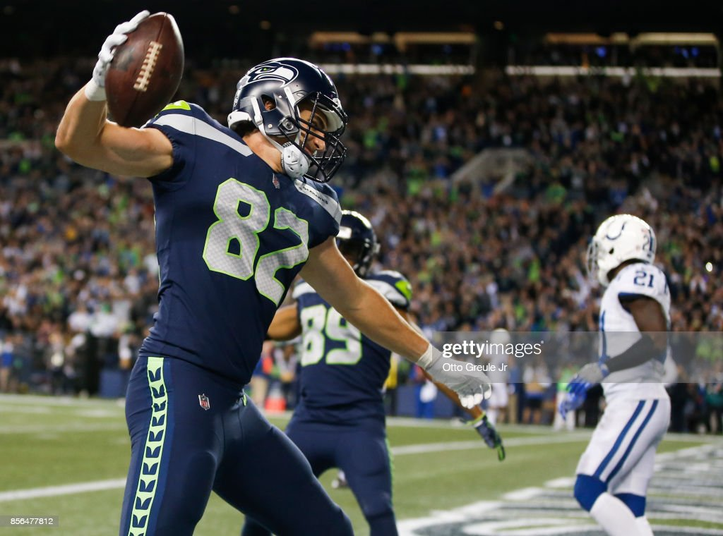 Tight end Luke Willson #82 of the Seattle Seahawks spikes the ball as he celebrates his touchdown against the Indianapolis Colts in the fourth quarter of the game at CenturyLink Field on October 1, 2017 in Seattle, Washington.