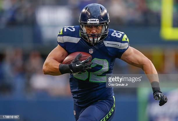 Tight end Luke Wilson of the Seattle Seahawks rushes against the Oakland Raiders at CenturyLink Field on August 29 2013 in Seattle Washington