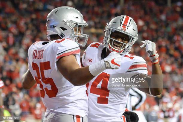 Tight end Marcus Baugh of the Ohio State Buckeyes celebrates with wide receiver KJ Hill after a score against the Nebraska Cornhuskers at Memorial...