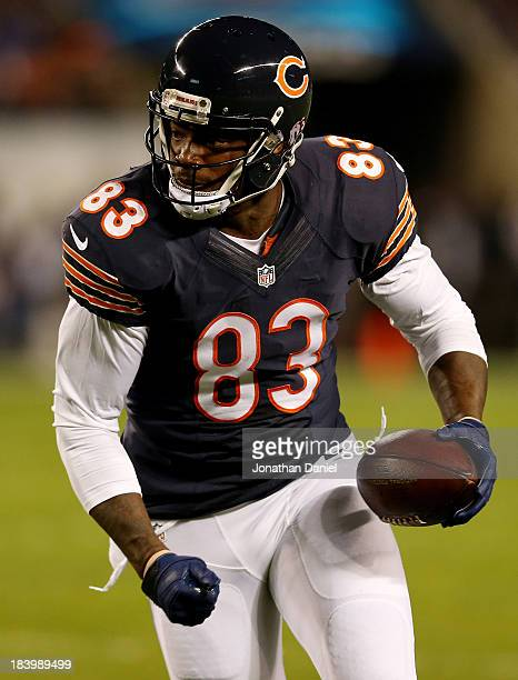 Tight end Martellus Bennett of the Chicago Bears runs with the ball after a reception against the New York Giants during a game at Soldier Field on...