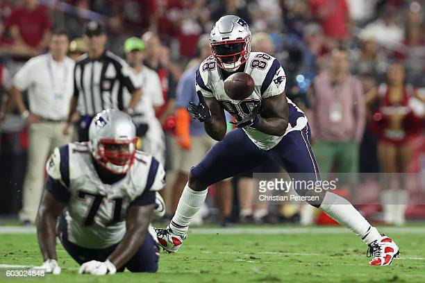 Tight end Martellus Bennett of the New England Patriots makes a reception against the Arizona Cardinals during the third quarter of the NFL game at...