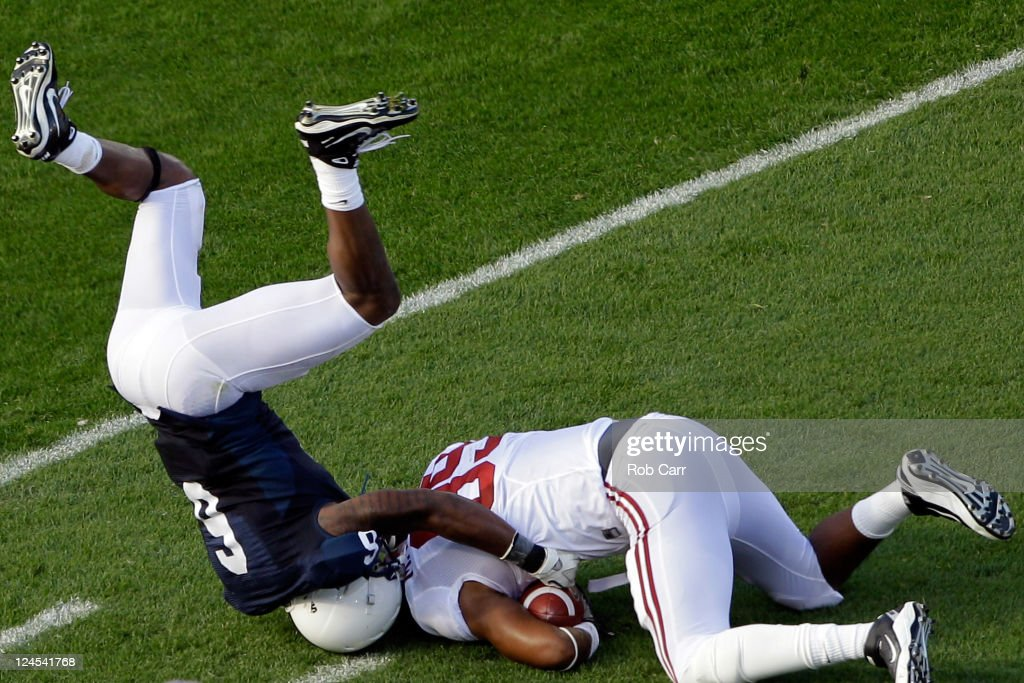 Tight end Michael Williams of the Alabama Crimson Tide is tackled by defender Gerald Hodges of the Penn State Nittany Lions after catching a pass...