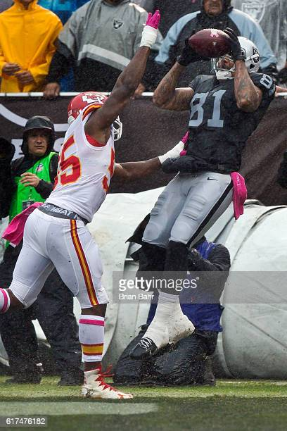 Tight end Mychal Rivera of the Oakland Raiders tries to turn a catch into a touchdown but can't get his foot in bounds against linebacker Dee Ford of...