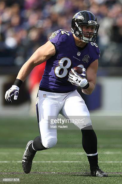 Tight end Nick Boyle of the Baltimore Ravens carries the ball in the first quarter of a game against the San Diego Chargers at MT Bank Stadium on...