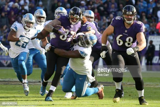 Tight End Nick Boyle of the Baltimore Ravens runs with the ball in the second quarter as he is tackled by defensive tackle A'Shawn Robinson of the...