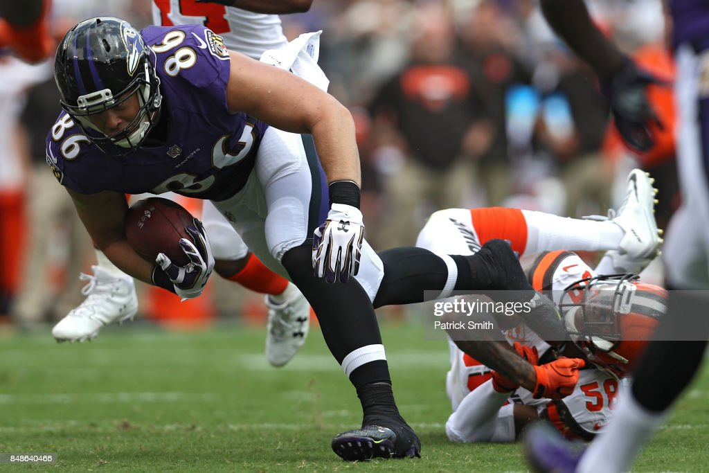 Tight end Nick Boyle #86 of the Baltimore Ravens rushes past outside linebacker Christian Kirksey #58 of the Cleveland Browns during the first half at M&T Bank Stadium on September 17, 2017 in Baltimore, Maryland.