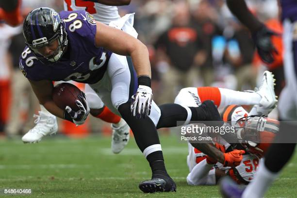 Tight end Nick Boyle of the Baltimore Ravens rushes past outside linebacker Christian Kirksey of the Cleveland Browns during the first half at MT...