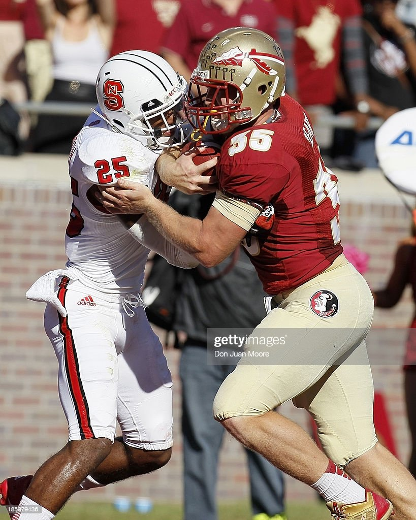 Tight end Nick O'Leary #35 of the Florida State Seminoles makes a running play against safey Dontae Johnson #25 of the North Carolina State Wolfpack at Bobby Bowden Field at Doak Campbell Stadium on October 26, 2013 in Tallahassee, Florida. The 3rd ranked Florida State Seminoles defeated North Carolina State Wolfpack 49-17.