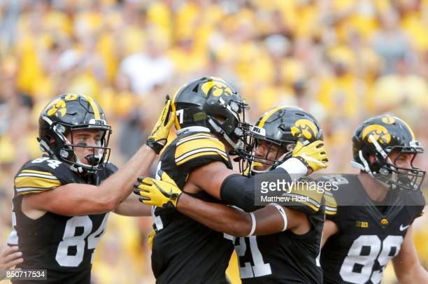 Tight end Noah Fant of the Iowa Hawkeyes celebrates a touchdown with running back Ivory KellyMartin the third quarter against the North Texas Mean...