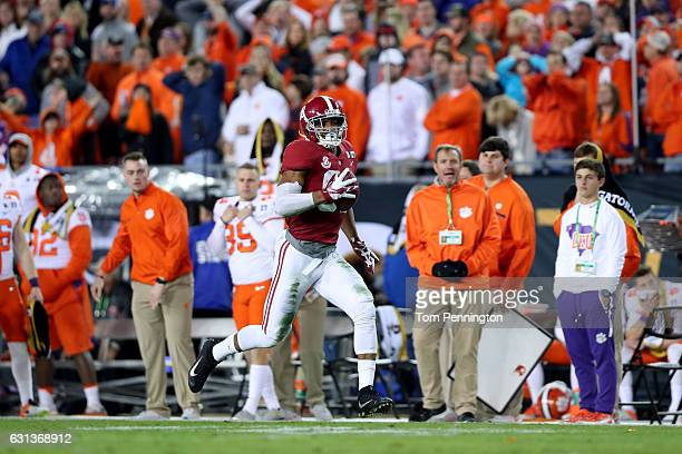 Tight end OJ Howard of the Alabama Crimson Tide runs to the end zone after making a 68yard touchdown reception during the third quarter against the...