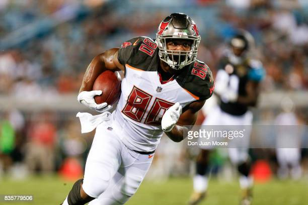 Tight End OJ Howard of the Tampa Bay Buccaneers on a catch and run play during the game against the Jacksonville Jaguars at EverBank Field on August...
