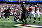 Tight end Owen Daniels of the Baltimore Ravens celebrates after scoring a first quarter touchdown against the Atlanta Falcons at MT Bank Stadium on...
