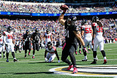 Tight end Owen Daniels of the Baltimore Ravens celebrates after catching a first quarter touchdown pass against the Atlanta Falcons at MT Bank...