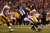 Tight end Owen Daniels of the Baltimore Ravens is tackled by strong safety Troy Polamalu of the Pittsburgh Steelers at MT Bank Stadium on September...