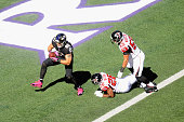 Tight end Owen Daniels of the Baltimore Ravens scores a first quarter touchdown past the defense of cornerback Josh Wilson of the Atlanta Falcons and...