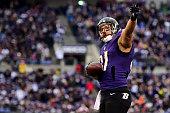 Tight end Owen Daniels of the Baltimore Ravens signals after a long third quarter reception against the Jacksonville Jaguars at MT Bank Stadium on...