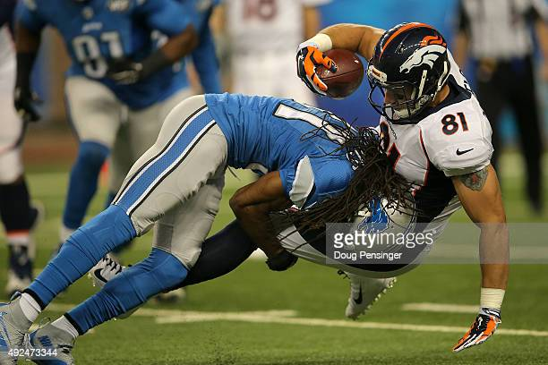Tight end Owen Daniels of the Denver Broncos is tackled by cornerback Rashean Mathis of the Detroit Lions at Ford Field on September 27 2015 in...