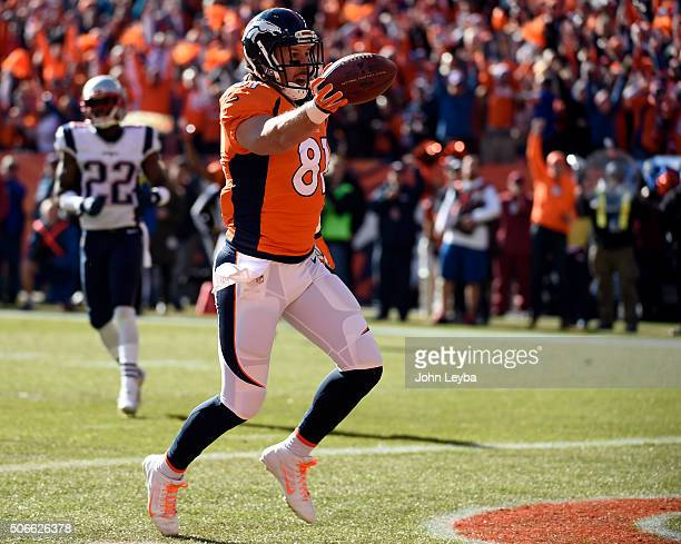 Tight end Owen Daniels of the Denver Broncos makes a catch from quarterback Peyton Manning of the Denver Broncos and scores the Broncos first...