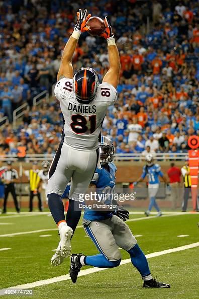 Tight end Owen Daniels of the Denver Broncos makes a touchdown reception against cornerback Quandre Diggs of the Detroit Lions at Ford Field on...