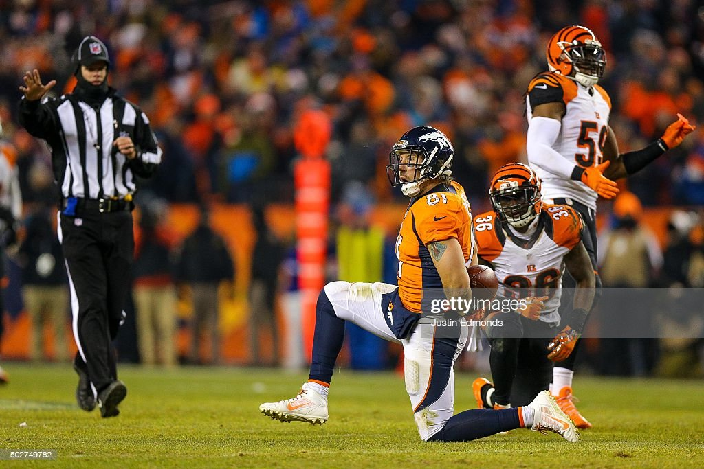 Tight end Owen Daniels of the Denver Broncos reacts after making a 26 yard reception for a first down against cornerback Shawn Williams of the...