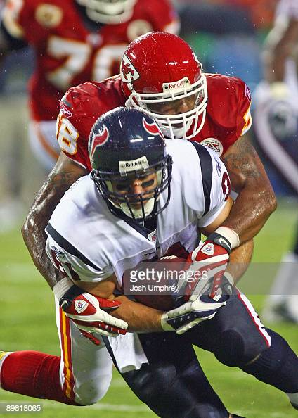 Tight end Owen Daniels of the Houston Texans is tackled by safety DaJuan Morgan of the Kansas City Chiefs in a game at Arrowhead Stadium on August 15...