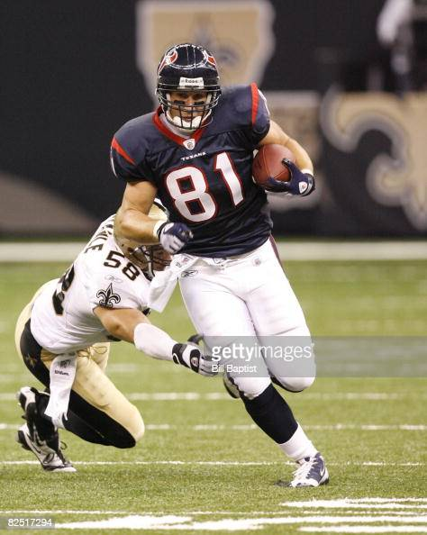 Tight end Owen Daniels of the Houston Texans runs the ball during a preseason game against the New Orleans Saints at The Superdome on August 16 2008...