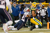 Tight end Richard Rodgers of the Green Bay Packers scores a touchdown on a 32 yard pass form Aaron Rodgers as strong safety Patrick Chung of the New...