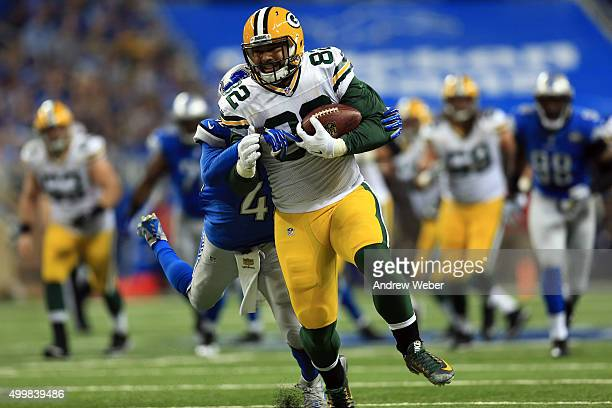Tight end Richard Rodgers of the Green Bay Packers tries to brake the tackle by strong safety Isa AbdulQuddus of the Detroit Lions during the second...