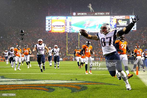 Tight end Rob Gronkowski of the New England Patriots celebrates after scoring a first quarter touchdown against the Denver Broncos at Sports...