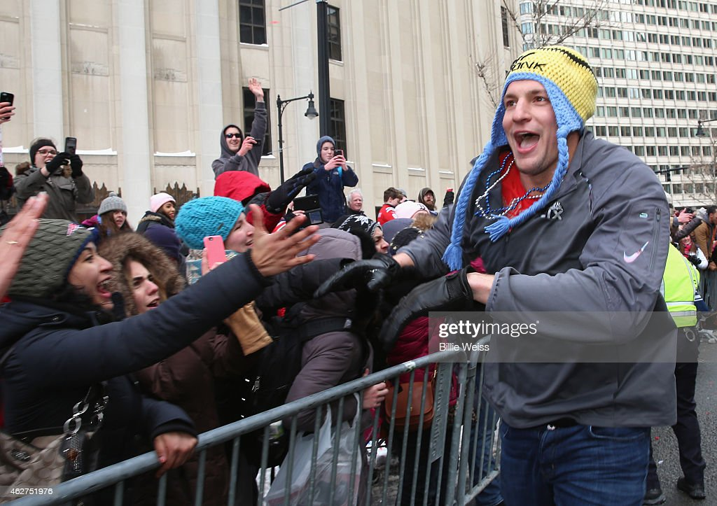Tight end Rob Gronkowski of the New England Patriots high fives fans during a Super Bowl victory parade on February 4 2015 in Boston Massachusetts...