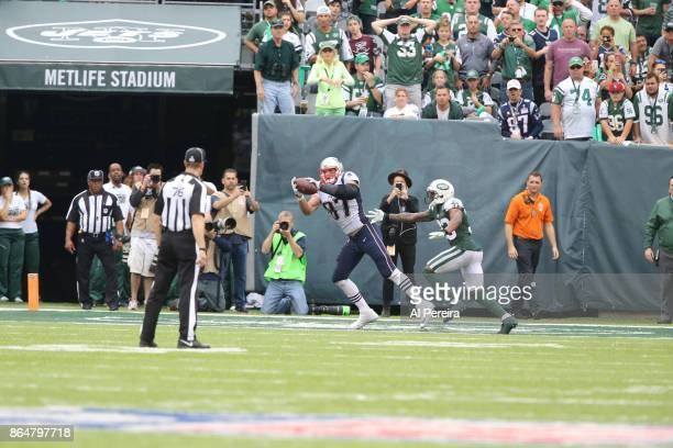 Tight End Rob Gronkowski of the New England Patriots scores a touchdown against the New York Jets during their game at MetLife Stadium on October 15...