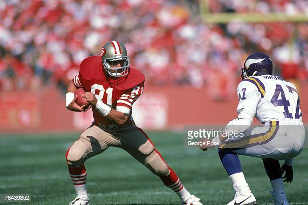 Tight end Russ Francis of the San Francisco 49ers makes a move against Minnesota Vikings safety Joey Browner during a game at Candlestick Park on...