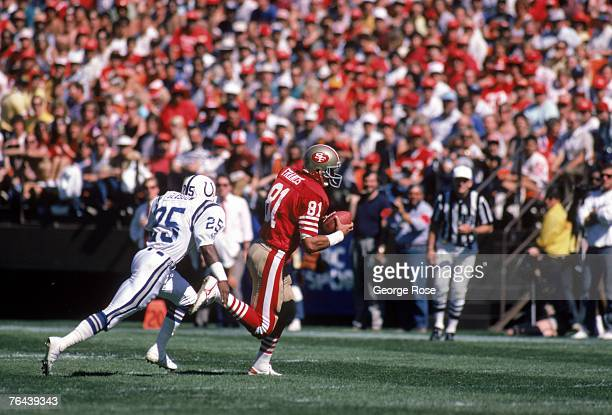 Tight end Russ Francis of the San Francisco 49ers runs with the ball after the catch against safety Nesby Glasgow of the Indianapolis Colts during a...