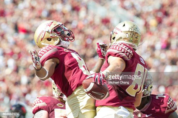 Tight end Ryan Izzo of the Florida State Seminoles celebrates with wide receiver Nyqwan Murray of the Florida State Seminoles after scoring a...