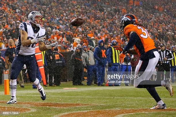 Tight end Scott Chandler of the New England Patriots scores a second quarter touchdown past strong safety David Bruton of the Denver Broncos at...