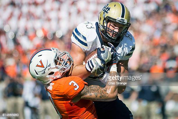 Tight end Scott Orndoff of the Pittsburgh Panthers wrestles with safety Quin Blanding of the Virginia Cavaliers during the Panthers' game against the...