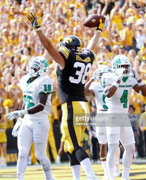 Tight end TJ Hockenson of the Iowa Hawkeyes celebrates a touchdown during the first quarter as in front of safety Khairi Muhammad and defensive back...