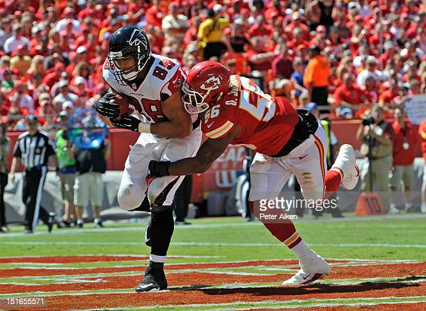 Tight end Tony Gonzalez of the Atlanta Falcons catches a 8yard touchdown pass against linebacker Derrick Johnson of the Kansas City Chiefs during the...