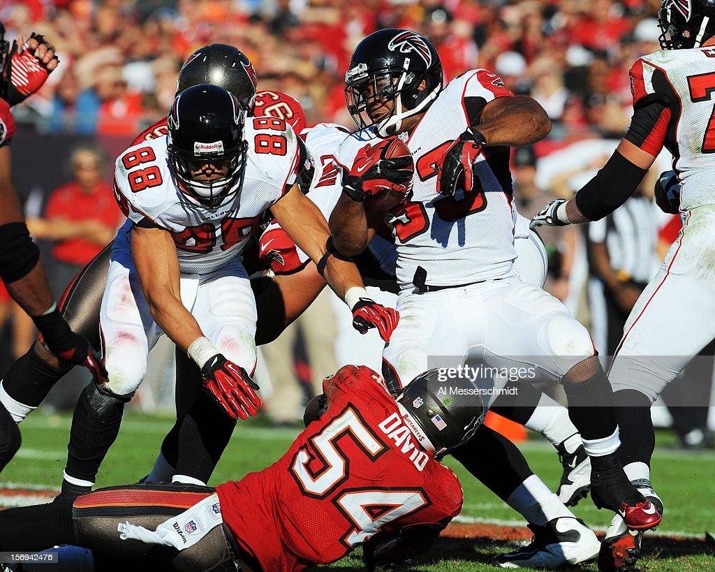Tight end <a gi-track='captionPersonalityLinkClicked' href=/galleries/search?phrase=Tony+Gonzalez+-+American+Football+Player&family=editorial&specificpeople=203240 ng-click='$event.stopPropagation()'>Tony Gonzalez</a> #88 of the Atlanta Falcons rblocks for running back Michael Turner #33 against the Tampa Bay Buccaneers November 25, 2012 at Raymond James Stadium in Tampa, Florida. The Falcons won 24 - 23.