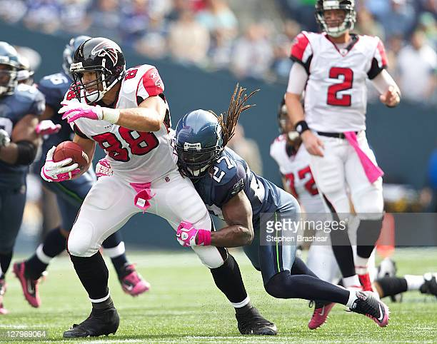Tight end Tony Gonzalez of the Atlanta Falcons tries to break the tackle of defensive back Atari Bigby of the Seattle Seahawks during play at...