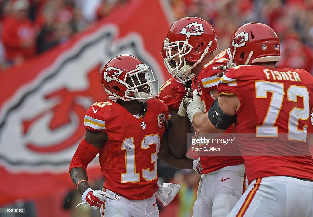 Tight end <a gi-track='captionPersonalityLinkClicked' href=/galleries/search?phrase=Travis+Kelce&family=editorial&specificpeople=6237659 ng-click='$event.stopPropagation()'>Travis Kelce</a> #87 of the Kansas City Chiefs celebrates with teammates <a gi-track='captionPersonalityLinkClicked' href=/galleries/search?phrase=De%27Anthony+Thomas&family=editorial&specificpeople=8222432 ng-click='$event.stopPropagation()'>De'Anthony Thomas</a> #13 and <a gi-track='captionPersonalityLinkClicked' href=/galleries/search?phrase=Eric+Fisher+-+American+Football+Player&family=editorial&specificpeople=10866831 ng-click='$event.stopPropagation()'>Eric Fisher</a> #72 after scoring a touchdown against the Oakland Raiders during the second half on December 14, 2014 at Arrowhead Stadium in Kansas City, Missouri.