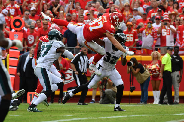 ... Multicolored Tight end Travis Kelce 87 of the Kansas City Chiefs leaps  into the end zone ... 909dc7938