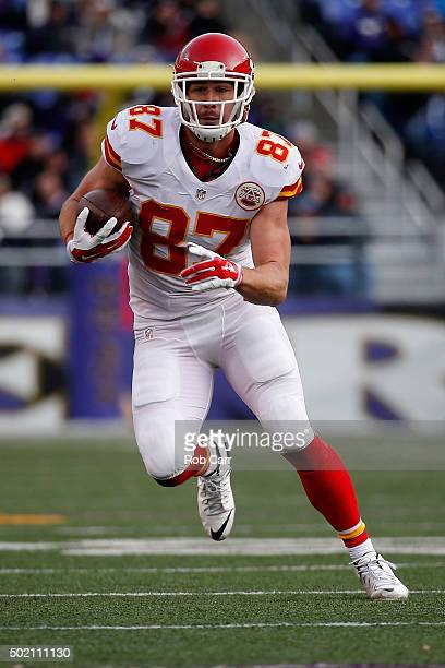 Tight end Travis Kelce of the Kansas City Chiefs runs with the ball after catching a pass in the second half against the Baltimore Ravens at MT Bank...