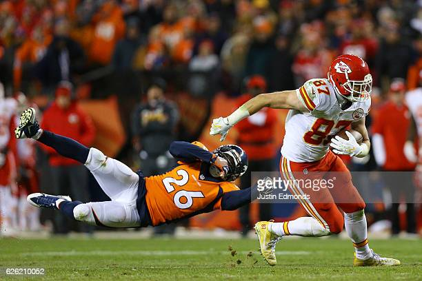 Tight end Travis Kelce of the Kansas City Chiefs shakes off free safety Darian Stewart of the Denver Broncos after catching a pass in overtime at...