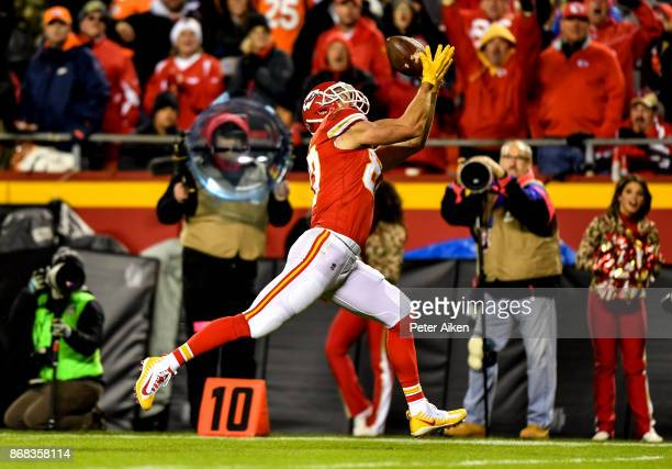 Tight end Travis Kelce of the Kansas City Chiefs stretches out for a catch that would lead the second touchdown of the game against the Denver...