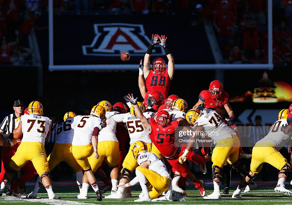 Tight end Trevor Wood of the Arizona Wildcats leaps as he attempts to block an unsuccessful field goal kicked by place kicker Zane Gonzalez of the...