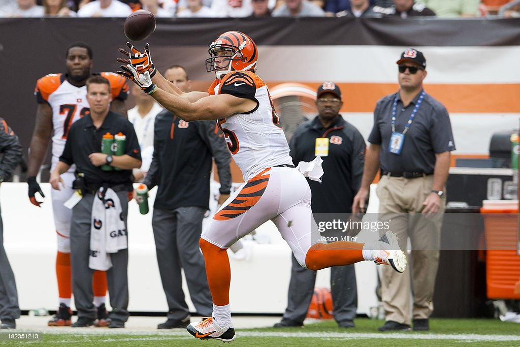 Tight end Tyler Eifert #85 of the Cincinnati Bengals catches a pass from quarterback Andy Dalton #14 during the second half against the Cleveland Browns at FirstEnergy Stadium on September 29, 2013 in Cleveland, Ohio. The Browns defeated the Bengals 17-6.