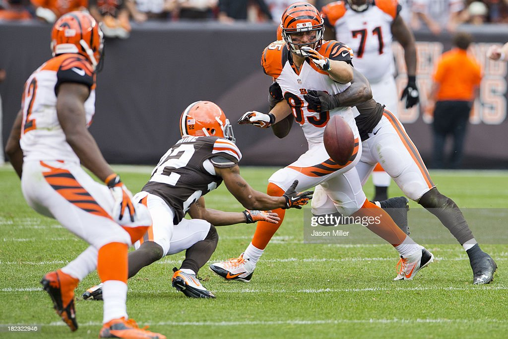 Tight end Tyler Eifert #85 of the Cincinnati Bengals watches as an incomplete pass is fought for an interception by cornerback <a gi-track='captionPersonalityLinkClicked' href=/galleries/search?phrase=Buster+Skrine&family=editorial&specificpeople=6547689 ng-click='$event.stopPropagation()'>Buster Skrine</a> #22 of the Cleveland Browns during the second half at FirstEnergy Stadium on September 29, 2013 in Cleveland, Ohio. The Browns defeated the Bengals 17-6.